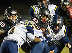Lawndale, CA 10/07/16 - Angel Becerra (Lawndale #56), Kayden Thomas (Santa Monica #4), Benz Marylander (Santa Monica #26) and \l23\ in action during the CIF Bay League game between Santa Monica and Lawndale.