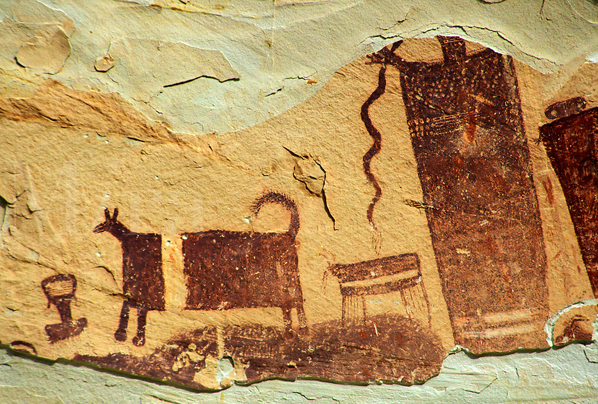 Petroglyph of human figures and banded cow on canyon wall, Horseshoe Canyon Unit, Maze District, Canyonlands National Park, Utah.