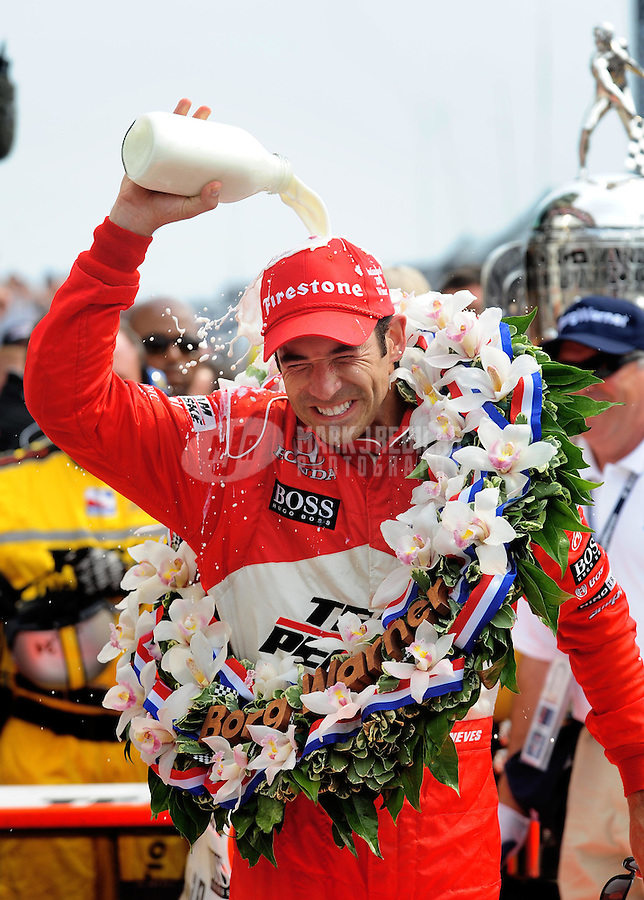 May 24, 2009; Indianapolis, IN, USA; IRL driver Helio Castroneves celebrates after winning the 93rd running of the Indianapolis 500 at Indianapolis Motor Speedway.  Mandatory Credit: Mark J. Rebilas-