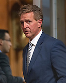 United States Senator Jeff Flake (Republican of Arizona) arrives prior to making a statement to the US Senate Committee on the Judiciary prior to a vote on the nomination of Judge Brett Kavanaugh to be Associate Justice of the US Supreme Court to replace the retiring Justice Anthony Kennedy on Capitol Hill in Washington, DC on Friday, September 28, 2018.  If the committee votes in favor of Judge Kavanaugh then it goes to the full US Senate for a final vote.  Flake voted to send the nomination to the US Senate floor but asked that the final vote be delayed pending an FBI check on the incident between Dr. Ford and Judge Kavanaugh when they were in high school.<br /> Credit: Ron Sachs / CNP<br /> (RESTRICTION: NO New York or New Jersey Newspapers or newspapers within a 75 mile radius of New York City)