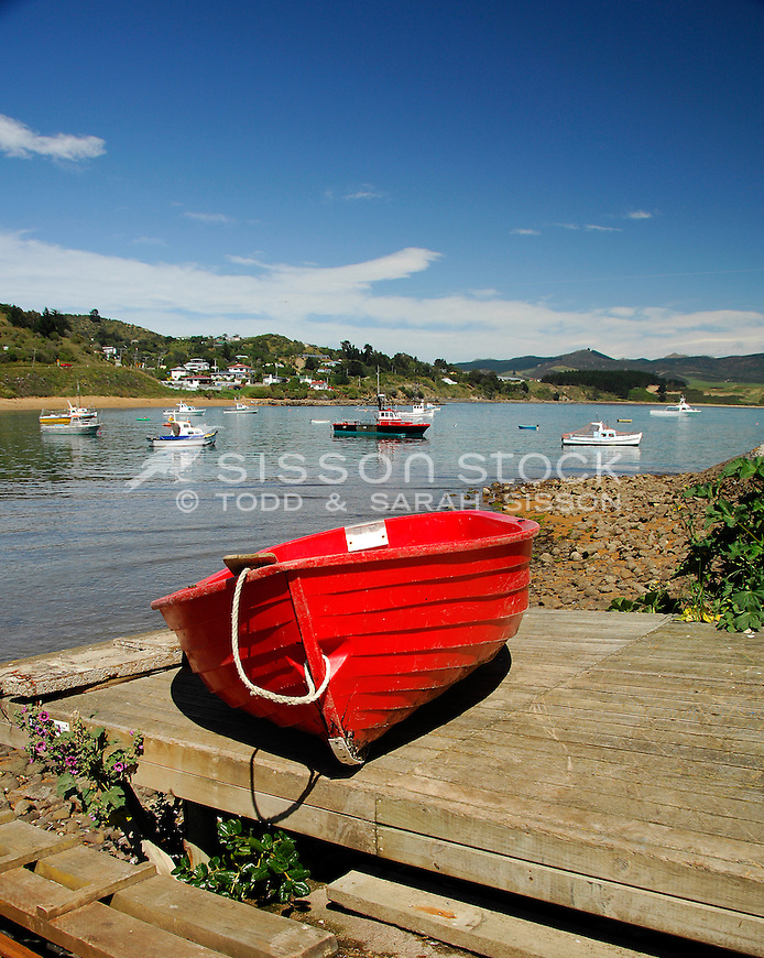 Red boat on the dock at Fleur's Restaurant, Moeraki Village, Coastal Otago