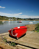 Red boat on the dock at Fleur's Restaurant, Moeraki Village, Coastal Otago