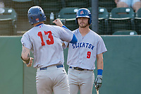 Stockton Ports center fielder Skye Bolt (9) congratulates catcher Jonah Heim (13) after hitting a home run during a California League game against the Visalia Rawhide at Visalia Recreation Ballpark on May 8, 2018 in Visalia, California. Stockton defeated Visalia 6-2. (Zachary Lucy/Four Seam Images)