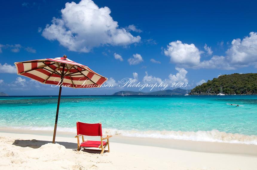 Red chair and striped umbrella<br /> Hawksnest Beach<br /> Virgin Islands National Park <br /> St. John, U.S. Virgin Islands