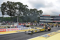 Jun. 1, 2012; Englishtown, NJ, USA: NHRA top fuel dragster driver Morgan Lucas (near lane) races alongside Antron Brown during qualifying for the Supernationals at Raceway Park. Mandatory Credit: Mark J. Rebilas-