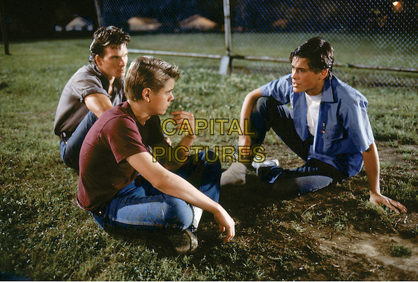 PATRICK SWAYZE, C. THOMAS HOWELL & ROB LOWE.in The Outsiders.*Filmstill - Editorial Use Only*.CAP/FB.Supplied by Capital Pictures.