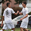 Will Taffe #18 of Syosset, left, gets congratulated by teammate Jack Monfort #8 after scoring a goal in the second half of a Nassau County Conference AA-1 varsity boys soccer game against host Uniondale High School on Tuesday, Oct. 2, 2018. Syosset won by a score of 2-0.