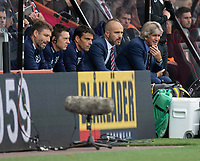 West Ham United manager Manuel Pellegrini (right) and the staff on the front bench<br /> <br /> Photographer David Horton/CameraSport<br /> <br /> The Premier League - Bournemouth v West Ham United - Saturday 28th September 2019 - Vitality Stadium - Bournemouth<br /> <br /> World Copyright © 2019 CameraSport. All rights reserved. 43 Linden Ave. Countesthorpe. Leicester. England. LE8 5PG - Tel: +44 (0) 116 277 4147 - admin@camerasport.com - www.camerasport.com