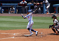 25th July 2020, Los Angeles, California, USA;  Los Angeles Dodgers third baseman Justin Turner (10) gets a hit during the game against the San Francisco Giants on July 25, 2020, at Dodger Stadium in Los Angeles, CA.