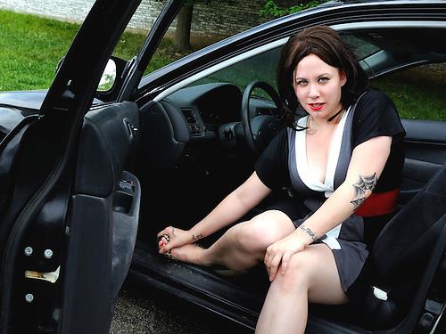 Model Exiting Car