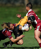 Christyl Stowers of Manurewa is tackled by Atawhai Tupaea and Ngatokotoru Orakua of Papakura.  Premier Women's Rugby League, Papakura Sisters v Manurewa Wahine, Prince Edward Park, Auckland, Sunday 13th August 2017. Photo: Simon Watts / www.phototek.nz