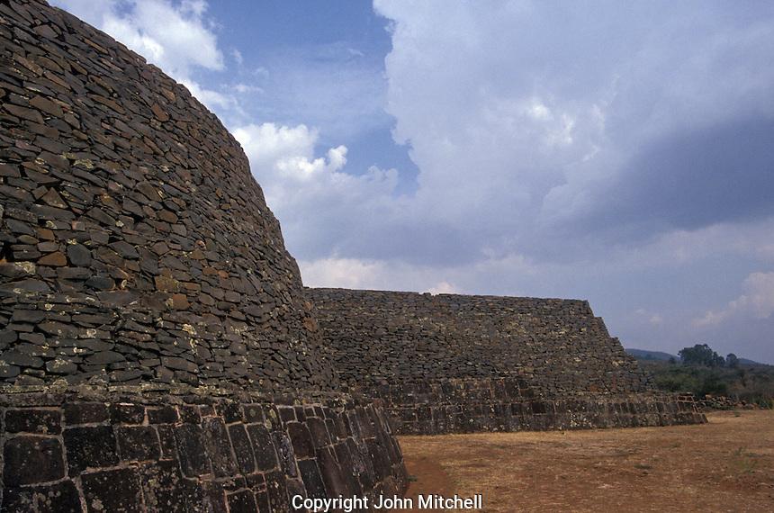 The Tarascan ruins of Tzintzuntzan near Patzcuaro , Michoacan , Mexico. These Purepecha pyramids are known as yacatas.