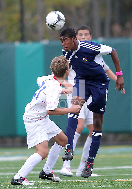 HYATTSVILLE, MD - OCTOBER 26, 2012:  Nolan Axenfeld (21) of DeMatha Catholic High School looks up to a header by Azaan Wilbon (15) of St. Albans during a match at Heurich Field in Hyattsville, MD. on October 26. DeMatha won 2-0.
