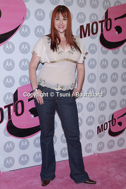 """Sarah Rue arriving at the Motorola 5th Anniversary Party to benefit """" Toys For Tots """" at the Hayden Place in Los Angeles. December 4, 2003."""