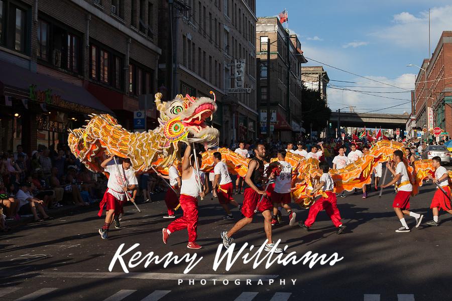 Orange Dragon Dance, Chinatown Seafair Parade 2015, Seattle, Washington State, WA, America, USA.
