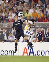 New England Revolution defender Seth Sinovic (27) battle for head ball. The New England Revolution defeated Monarcas Morelia in SuperLiga 2010 group stage match, 1-0, at Gillette Stadium on July 20, 2010.