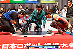 International robot operators compete to win the International Robot Sumo Tournament 2016 at the Ryougoku Sumo Hall (Ryogoku Kokugikan) on December 18, 2016, Tokyo, Japan. The annual tournament invites the top-ranked winners of 16 national competitions to compete in Japan. It is organized by the All Japan Robot-Sumo Tournament which has been held since 1989. According to the rules the robot wrestler loses when their robot is forced out of the sumo ring. (Photo by Rodrigo Reyes Marin/AFLO)