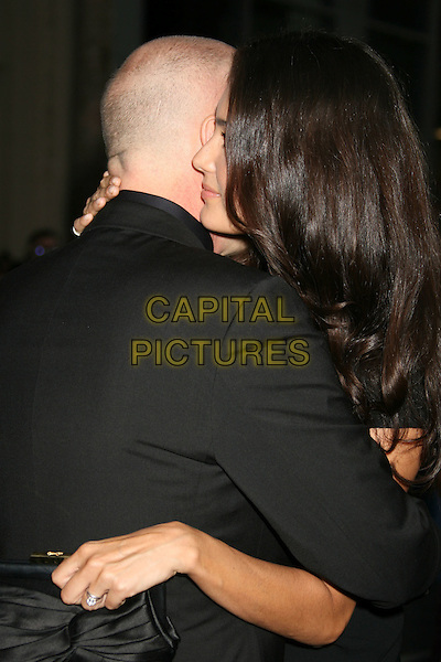 EMMA HEMIING & BRUCE WILLIS .'Surrogates' World Premiere held at the El Capitan Theatre, .Hollywood, CA, USA, .24th September 2009..half length married couple husband wife  black hugging wedding diamond hand ring finger .CAP/ADM/MJ.©Michael Jade/AdMedia/Capital Pictures.