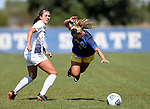 BROOKINGS, SD - SEPTEMBER 17:  Kaitlin Zabel #4 from South Dakota State University gets tripped up by Maddie Roberts #21 from Northern Colorado during their game Sunday afternoon at Fischback Soccer Field in Brookings. (Photo by Dave Eggen/Inertia)