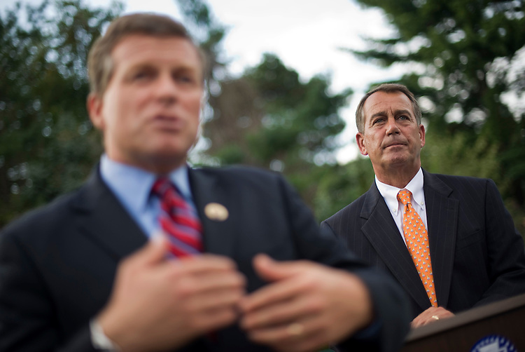 UNITED STATES - AUGUST 13:  Charlie Dent, R-Pa., addresses the crowd at a fundraiser for his campaign as House Minority Leader John Boehner, R-Ohio, looks on, in Easton, Pa.  Dent is being challenged for the PA-15 seat by democrat John Callahan. (Photo By Tom Williams/Roll Call via Getty Images)