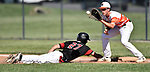 Triad baserunner Josh Mesenbrink dives back to first base to avoid a pickoff throw to Waterloo first baseman Ty Kueper. Triad defeated Waterloo 4-2 in a Class 3A Baseball Regional semifinal baseball game on Thursday May 24, 2018. Tim Vizer | Special to STLhighschoolsports.com