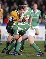 Australian skipper Brett Gillespie is tackled by Ireland's Conor Cleary during the Division A U19 World Championship clash at Ravenhill.