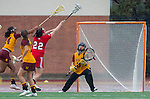 Los Angeles, CA 02/28/14 - Alexa Wilson (USC #13), Liz Shaeffer (USC #11), Drew Jackson (USC #14) and Kirsten Viscount (Marist #22) in action during the Marist Red Foxes vs University of Southern California Trojans NCAA Women's lacrosse game at Loker Track Stadium on the USC Campus.  Marist defeated USC 12-10.