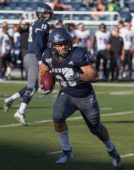 Nevada's Toa Taua (35) runs in the Nevada vs Weber State football game in Reno, Nevada on Saturday, Sept. 14, 2019.