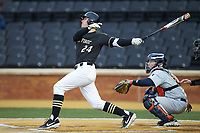 Chris Lanzilli (24) of the Wake Forest Demon Deacons follows through on his swing against the Illinois Fighting Illini at David F. Couch Ballpark on February 16, 2019 in  Winston-Salem, North Carolina.  The Fighting Illini defeated the Demon Deacons 5-2. (Brian Westerholt/Four Seam Images)