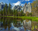 Yosemite National Park, Ca<br /> Cathedral Rocks reflecting in a vernal pool in early spring in Yosemite Valley