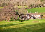 Exmoor farmhouse set amongst trees Brandish Street hamlet, Selworthy, Somerset, England