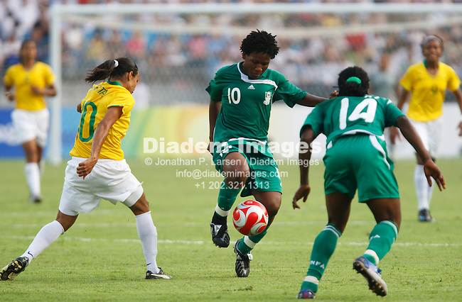 BEIJING, CHINA - AUGUST 12:  Rita Chikwelu of Nigeria (10) kicks the ball during a Beijing Olympic Games women's soccer tournament match against Brazil August 12, 2008 at Workers' Stadium in Beijing, China.  Editorial use only.  (Photograph by Jonathan Larsen)