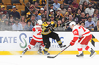 September 26, 2018: Boston Bruins left wing Brad Marchand (63) checks Detroit Red Wings defenseman Joe Hicketts (2) during the NHL pre-season game between the Detroit Red Wings and the Boston Bruins held at TD Garden, in Boston, Mass. Detroit defeats Boston 3-2 in overtime. Eric Canha/CSM