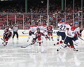 Tanner Pond (NU - 22), Adam Chapie (UML - 13), Mike Jamieson (NU - 24), Scott Wilson (UML - 23), Mike Gunn (NU - 6), Zack Kamrass (UML - 27), Jake Suter (UML - 28) - The Northeastern University Huskies defeated the University of Massachusetts Lowell River Hawks 4-1 (EN) on Saturday, January 11, 2014, at Fenway Park in Boston, Massachusetts.