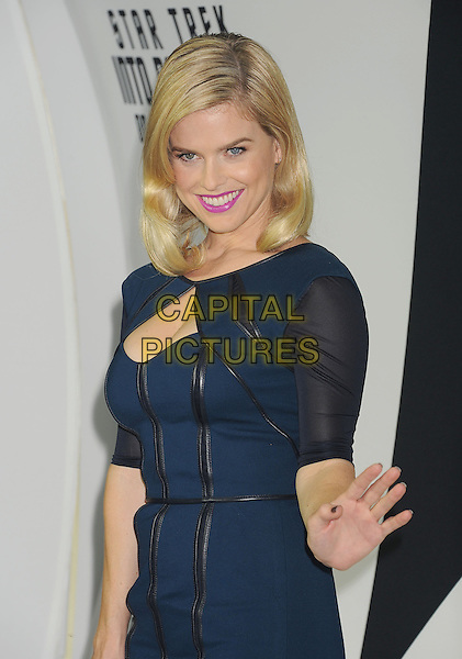 Alice Eve<br /> &quot;Star Trek Into Darkness&quot; DVD/Blu-Ray Release held at the California Science Center, Los Angeles, California, USA.<br /> September 10th, 2013<br /> half length blue dress black cut out away stripe strips leather hand arm waving<br /> CAP/ROT/TM<br /> &copy;Tony Michaels/Roth Stock/Capital Pictures