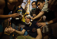 An injured pro-democracy protester recieves medical attantion in Mong Kok on day six of the mass civil disobedience campaign Occupy Central, Mong Kok, Kowloon, Hong Kong, China, 02 October 2014. Pro-democracy protesters and foreign media were beseiged by a angry mob of paid pro-China goons for several hours as Hong Kong police were slow to bring in reinforcements to bring the situation under control. Several injuries were reported as anti-Occupy Central goons beat up several pro-democracy protesters.