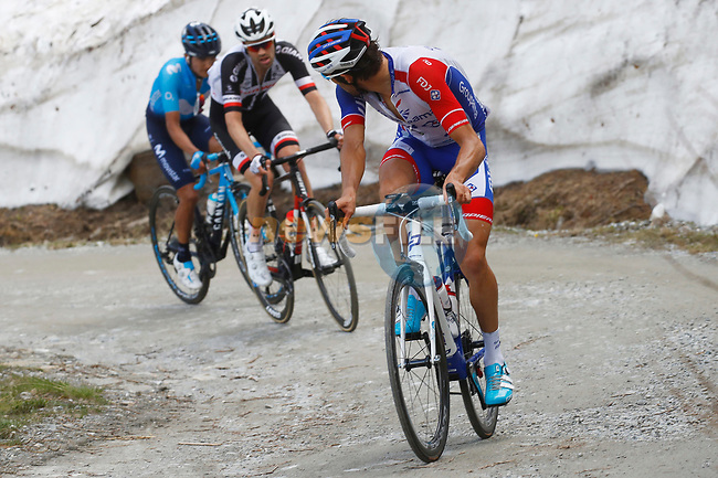 Thibaut Pinot (FRA) Groupama-FDJ, Tom Dumoulin (NED) Team Sunweb and Richard Carapaz (ECU) Movistar Team on the Colle delle Finestre during Stage 19 of the 2018 Giro d'Italia, running 185km from Venaria Reale to Bardonecchia featuring the Cima Coppi of this Giro, the highest climb on the Colle delle Finestre with its gravel roads, before finishing on the final climb of the Jafferau, Italy. 25th May 2018.<br /> Picture: LaPresse/POOL Luca Bettini/BettiniPhoto | Cyclefile<br /> <br /> <br /> All photos usage must carry mandatory copyright credit (© Cyclefile | LaPresse/POOL Luca Bettini/BettiniPhoto)