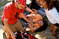 AJ Alexander/AAP - First Aid Help is provided to a girl at the Student's Walk Out from school to Protest at State Capitol in Phoenix, Arizona on Friday March 4, 2011..Photo by AJ Alexander