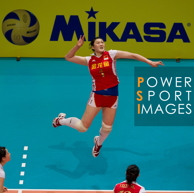 22 August 2010, Hong Kong, China ---  China's Wang Yimei spikes the ball against USA during their volleyball game on the last day of the FIVB World Grand Prix Pool G at the Hong Kong Coliseum stadium. Photo by Victor Fraile --- Image by © Victor Fraile
