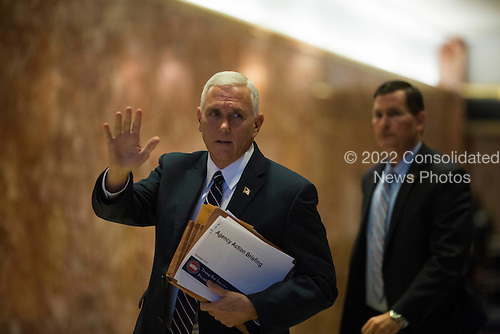 United States Vice President-elect Mike Pence waves to members of the media at Trump Tower in Manhattan, New York, U.S., on Friday, November 18, 2016.<br /> Credit: John Taggart / Pool via CNP