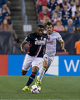 Foxborough, Massachusetts - August 13, 2016: First half action. In a Major League Soccer (MLS) match, New England Revolution (blue/white) vs Philadelphia Union (white), at Gillette Stadium.