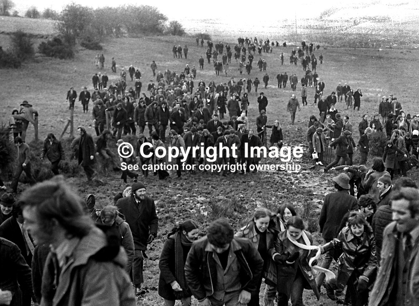 Participants in a banned anti-internment march between Dungannon and Coalisland took to the fields to circumvent a British Army roadblock. 23rd January 1972. 197201230083a<br /> <br /> Copyright Image from Victor Patterson, 54 Dorchester Park, Belfast, UK, BT9 6RJ<br /> <br /> t1: +44 28 9066 1296<br /> t2: +44 28 9002 2446<br /> m: +44 7802 353836<br /> <br /> e1: victorpatterson@me.com<br /> e2: victorpatterson@gmail.com<br /> <br /> www.victorpatterson.com<br /> <br /> IMPORTANT: Please see my Terms and Conditions of Use at www.victorpatterson.com