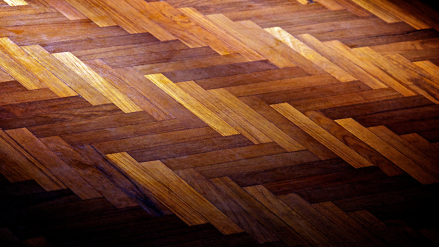 A parquet floor catches the late afternoon sun.