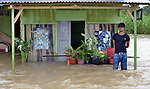 A house inundated during November 2014 flooding in Meulaboh in Indonesia's Aceh province. Flooding in the region has grown worse because of climate change and the proliferation of palm oil plantations.