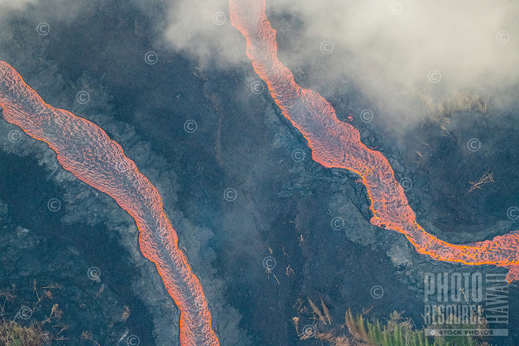 May 2018: An aerial view of enormous lava rivers in the Puna district, Big Island of Hawai'i; they originated in Leilani Estates in another part of Puna.