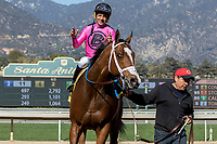 ARCADIA, CA  FEBRUARY 24: #4 Conquest Tsunami, a survivor of the San Luis Rey fire, ridden by Victor Espinoza, returns to the connections after winning the  Daytona Stakes (Grade lll) on February 24, 2018, at Santa Anita Park in Arcadia, CA. (Photo by Casey Phillips/ Eclipse Sportswire/ Getty Images)