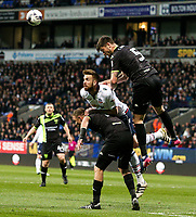Bolton Wanderers' Mark Beevers jumps for a header with Bury's Cameron Burgess and Tom Pope<br /> <br /> Photographer Alex Dodd/CameraSport<br /> <br /> The EFL Sky Bet League One - Bolton Wanderers v Bury - Tuesday 18th April 2017 - Macron Stadium - Bolton<br /> <br /> World Copyright &copy; 2017 CameraSport. All rights reserved. 43 Linden Ave. Countesthorpe. Leicester. England. LE8 5PG - Tel: +44 (0) 116 277 4147 - admin@camerasport.com - www.camerasport.com