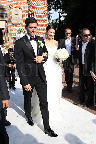 22.06.2013. Warsaw, Poland.  Wedding Robert Lewandowski and Anna Stachurska are shown as they marry after a long courtship. Lewandowski is a professional footballer who plays in the Bundesliga for Dortmund and Stachurska is a well reknowned karata champion in Poland.