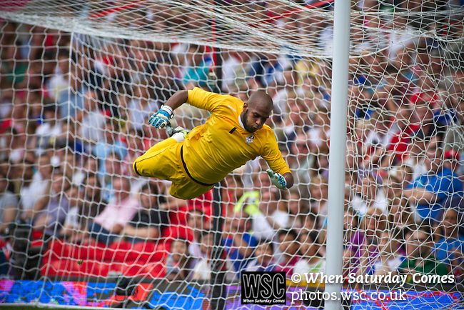 Uruguay 2 United Arab Emirates 1, Great Britain 1 Senegal 1, 26/07/2012. Old Trafford, Olympic Games. United Arab Emirates goalkeeper Ali Khaseif cannot prevent Uruguay's Ramirez's equalising goal at Manchester United's Old Trafford stadium during the first half of their opening match at the Men's Olympic Football tournament. The double header of games resulted in Uruguay defeating the United Arab Emirates by 2-1 while Great Britain and Senegal drew 1-1. Over 72,000 spectators attended the two Group A matches. Photo by Colin McPherson.