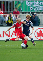 22 May 2010: New England Revolution defender Pat Phelan #28 Toronto FC forward Chad Barrett #19 in action during a game between the New England Revolution and Toronto FC at BMO Field in Toronto..Toronto FC won 1-0.....